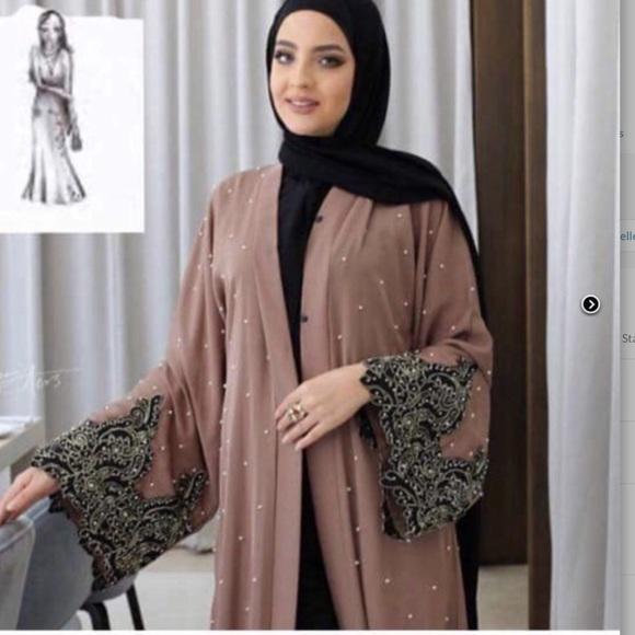 A beautiful luxury made in pearl Dubai Abaya  Boutique